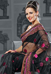 A desire that evokes a sense of belonging with a striking details. This black net saree is nicely designed with embroidered patch work is done with resham and zari work. Beautiful embroidery work on saree make attractive to impress all. This saree gives you a modern and different look in fabulous style. Matching blouse is available. Slight color variations are possible due to differing screen and photograph resolution.