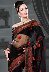 Look stunning rich with dark shades and floral patterns This black net saree is nicely designed with embroidered patch work is done with resham and zari work. Beautiful embroidery work on saree make attractive to impress all. This saree gives you a modern and different look in fabulous style. Matching blouse is available. Slight color variations are possible due to differing screen and photograph resolution.