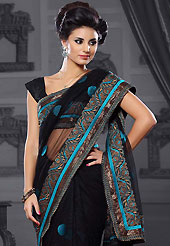 The evolution of style species collection spells pure femininity. This black net saree is nicely designed with embroidered patch work is done with resham and zari work. Beautiful embroidery work on saree make attractive to impress all. This saree gives you a modern and different look in fabulous style. Matching blouse is available. Slight color variations are possible due to differing screen and photograph resolution.