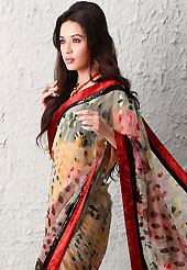 Get ready to sizzle all around you by sparkling saree. This cream, mustard and pink brasso faux georgette saree is nicely designed with floral print and sequins work. Beautiful embroidery work on saree make attractive to impress all. This saree gives you a modern and different look in fabulous style. Contrasting navy blue blouse is available. Slight color variations are possible due to differing screen and photograph resolution.