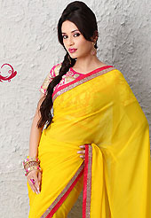Elegance and innovation of designs crafted for you. This yellow faux chiffon saree is nicely designed with zari and sequins work. Beautiful embroidery work on saree make attractive to impress all. This saree gives you a modern and different look in fabulous style. Contrasting pink blouse is available. Slight color variations are possible due to differing screen and photograph resolution.