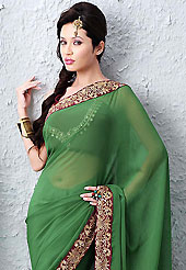 The most beautiful refinements for style and tradition. This green faux chiffon saree is nicely designed with zari and sequins work. Beautiful embroidery work on saree make attractive to impress all. This saree gives you a modern and different look in fabulous style. Matching blouse is available. Slight color variations are possible due to differing screen and photograph resolution.