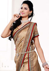 Style and trend will be at the peak of your beauty when you adorn this saree. This fawn art silk saree is nicely designed with embroidered patch work is done with resham, zari and sequins work. Beautiful embroidery work on saree make attractive to impress all. This saree gives you a modern and different look in fabulous style. Matching blouse is available. Slight color variations are possible due to differing screen and photograph resolution.