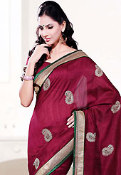 It is color this season and bright shaded suits are really something that is totally in vogue. This deep pink art silk saree is nicely designed with embroidered patch work is done with resham, zari and sequins work. Beautiful embroidery work on saree make attractive to impress all. This saree gives you a modern and different look in fabulous style. Matching blouse is available. Slight color variations are possible due to differing screen and photograph resolution.