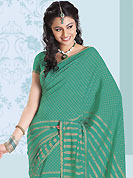 Take a look on the changing fashion of the season. This beautiful green faux chiffon saree is nicely designed with paisley and dots print work. Beautiful print work on saree make attractive to impress all. It will enhance your personality and gives you a singular look. Matching blouse is available with this saree. Slight color variations are due to differing screen and photography resolution.