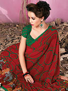 The traditional patterns used on this saree maintain the ethnic look. This beautiful red faux georgette saree is nicely designed with floral and geometric print work. Beautiful print work on saree make attractive to impress all. It will enhance your personality and gives you a singular look. Contrasting green blouse is available with this saree. Slight color variations are due to differing screen and photography resolution.