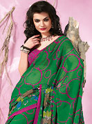Keep the interest with this printed saree. This beautiful green faux georgette saree is nicely designed with floral and geometric print work. Beautiful print work on saree make attractive to impress all. It will enhance your personality and gives you a singular look. Contrasting dark pink blouse is available with this saree. Slight color variations are due to differing screen and photography resolution.