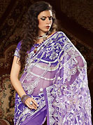 Make a trendy look with this classic embroidered saree. This purple net saree have beautiful embroidery patch work which is embellished with resham, zari and sequins work. Fabulous designed embroidery gives you an ethnic look and increasing your beauty. Matching blouse is available. Slight Color variations are possible due to differing screen and photograph resolutions.