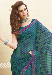 Era with extension in fashion, style, Grace and elegance have developed grand love affair with this ethnical wear. This teal green and blue faux georgette saree is nicely designed with floral print work. Saree gives you a singular and dissimilar look. Matching blouse is available. Slight color variations are possible due to differing screen and photograph resolution.