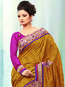 Let your personality articulate for you with this amazing embroidered saree. This dark mustard and magenta bhagalpuri jacquard silk saree is nicely designed with embroidered patch work is done with resham, zari, sequins and stone work. Saree gives you a singular and dissimilar look. Matching magenta blouse is available. Slight color variations are possible due to differing screen and photograph resolution.