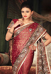 Embroidered sarees are the best choice for a girl to enhance her feminine look. This brown and red tissue brocade saree have beautiful embroidery patch work which is embellished with resham, stone and cutbeads work. Fabulous designed embroidery gives you an ethnic look and increasing your beauty. Matching blouse is available. This saree is also available in A Yellow, B Green colors. Slight Color variations are possible due to differing screen and photograph resolutions.