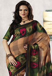 Era with extension in fashion, style, Grace and elegance have developed grand love affair with this ethnical wear. This beautiful light brown, green and black art silk saree is nicely designed with geometric and abstract print work. Beautiful print work on saree make attractive to impress all. It will enhance your personality and gives you a singular look. Matching blouse is available with this saree. Slight color variations are due to differing screen and photography resolution.
