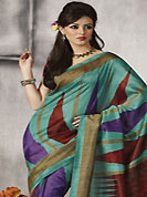 Exquisite combination of color, fabric can be seen here. This beautiful sea green, maroon and purple art silk saree is nicely designed with geometric print work. Beautiful print work on saree make attractive to impress all. It will enhance your personality and gives you a singular look. Matching blouse is available with this saree. Slight color variations are due to differing screen and photography resolution.