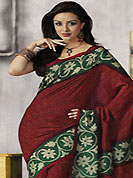 Make a trendy look with this classic printed saree. This beautiful red and green art silk saree is nicely designed with floral and abstract print work. Beautiful print work on saree make attractive to impress all. It will enhance your personality and gives you a singular look. Matching blouse is available with this saree. Slight color variations are due to differing screen and photography resolution.