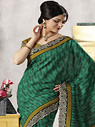 Envelope yourself in classic look with this charming saree. This beautiful green and mustard art silk saree is nicely designed with paisley and abstract print work. Beautiful print work on saree make attractive to impress all. It will enhance your personality and gives you a singular look. Matching blouse is available with this saree. Slight color variations are due to differing screen and photography resolution.