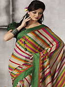 Make a trendy look with this classic printed saree. This beautiful light beige and green art silk saree is nicely designed with stripe print work. Beautiful print work on saree make attractive to impress all. It will enhance your personality and gives you a singular look. Matching green blouse is available with this saree. Slight color variations are due to differing screen and photography resolution.