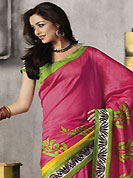 It is color this season and bright shaded suits are really something that is totally in vogue. This beautiful pink and pastel green art silk saree is nicely designed with abstract print work. Beautiful print work on saree make attractive to impress all. It will enhance your personality and gives you a singular look. Matching blouse is available with this saree. Slight color variations are due to differing screen and photography resolution.