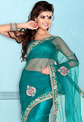 Era with extension in fashion, style, Grace and elegance have developed grand love affair with this ethnical wear. This teal green net saree is nicely designed with embroidered patch work is done with resham, zari, stone and lace work. Beautiful embroidery work on saree make attractive to impress all. This saree gives you a modern and different look in fabulous style. Matching blouse is available. Slight color variations are possible due to differing screen and photograph resolution.