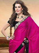 Embroidered sarees are the best choice for a girl to enhance her feminine look. This dark pink crepe saree is nicely designed with embroidered patch work is done with resham, zari, sequins and stone work. Beautiful embroidery work on saree make attractive to impress all. This saree gives you a modern and different look in fabulous style. Contrasting black blouse is available. Slight color variations are possible due to differing screen and photograph resolution.