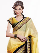 The most beautiful refinements for style and tradition. This shaded yellow and black chiffon jacquard saree is nicely designed with embroidered patch work is done with resham, zari, stone and lace work. Saree gives you a singular and dissimilar look. Matching blouse is available. Slight color variations are possible due to differing screen and photograph resolution.