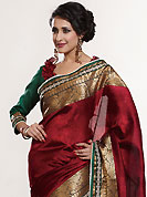 The traditional patterns used on this saree maintain the ethnic look. This maroon saree is nicely designed with embroidered patch work is done with self weaving zari, sequins and lace work. Saree gives you a singular and dissimilar look. Contrasting green blouse is available. Slight color variations are possible due to differing screen and photograph resolution.