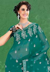 Era with extension in fashion, style, Grace and elegance have developed grand love affair with this ethnical wear. This beautiful teal green faux chiffon saree is nicely designed with resham, zari and stone work. Beautiful print work on saree make attractive to impress all. Matching blouse is available with this saree. Slight color variations are due to differing screen and photography resolution.