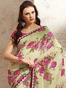 It is color this season and bright shaded suits are really something that is totally in vogue. This beautiful light pastel green and pink faux georgette saree is nicely designed with flower print and graceful patch border. Beautiful print work on saree make attractive to impress all. It will enhance your personality and gives you a singular look. Matching blouse is available with this saree. Slight color variations are due to differing screen and photography resolution.