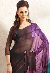 Envelope yourself in classic look with this charming saree. This beautiful deep brown, purple and blue faux georgette saree is nicely designed with abstract print. Beautiful print work on saree make attractive to impress all. It will enhance your personality and gives you a singular look. Matching blouse is available with this saree. Slight color variations are due to differing screen and photography resolution.