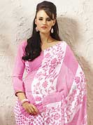 The most radiant carnival of style and beauty. This beautiful pink and off white faux georgette saree is nicely designed with floral, dots, stripe print, stone and graceful patch border. Beautiful print work on saree make attractive to impress all. It will enhance your personality and gives you a singular look. Matching blouse is available with this saree. Slight color variations are due to differing screen and photography resolution.