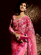 An occasion wear perfect is ready to rock you. This dark pink net saree is nicely designed with embroidered patch work is done with resham, stone and lace work. Beautiful embroidery work on saree make attractive to impress all. This saree gives you a modern and different look in fabulous style. Matching blouse is available. Slight color variations are possible due to differing screen and photograph resolution.