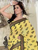 Era with extension in fashion, style, Grace and elegance have developed grand love affair with this ethnical wear. This yellow chiffon saree is nicely designed with embroidered patch work is done with resham and zari work. Beautiful embroidery work on saree make attractive to impress all. This saree gives you a modern and different look in fabulous style. Matching blouse is available. Slight color variations are possible due to differing screen and photograph resolution.