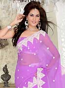 Try out this year top trend, glowing, bold and natural collection. This light lavender chiffon saree is nicely designed with embroidered patch work is done with resham and stone work. Beautiful embroidery work on saree make attractive to impress all. This saree gives you a modern and different look in fabulous style. Matching blouse is available. Slight color variations are possible due to differing screen and photograph resolution.