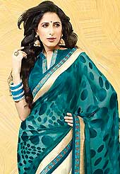 Envelope yourself in classic look with this charming saree. This teal green and off white saree is nicely designed with embroidered patch work is done with resham, zari and stone work. Saree gives you a singular and dissimilar look. Matching blouse is available. Slight color variations are possible due to differing screen and photograph resolution.