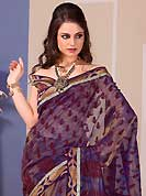 Take the fashion industry by storm in this beautiful embroidered saree. This beautiful dusty violet and dusty fawn tissue saree is nicely designed with floral print, zari, stone and graceful patch border. Beautiful print work on saree make attractive to impress all. It will enhance your personality and gives you a singular look. Contrasting maroon blouse is available with this saree. Slight color variations are due to differing screen and photography resolution.