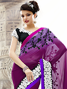 Get ready to sizzle all around you by sparkling saree. This lavender, deep magenta and purple faux georgette saree have beautiful embroidery patch work which is embellished with resham and sequins work. Fabulous designed embroidery gives you an ethnic look and increasing your beauty. Contrasting black blouse is available. Slight Color variations are possible due to differing screen and photograph resolutions.