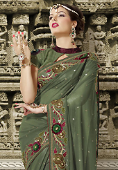 Take the fashion industry by storm in this beautiful embroidered saree. This shaded teal green net saree is nicely designed with embroidered patch work is done with resham and sequins work. Saree gives you a singular and dissimilar look. Matching blouse is available. Slight color variations are possible due to differing screen and photograph resolution.