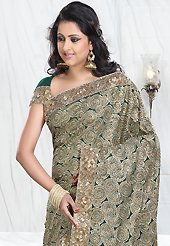 Elegance and innovation of designs crafted for you. This teal green crepe silk saree is nicely designed with embroidered patch work is done with resham, zari, sequins, stone, cutbeads and cutdana work. Saree gives you a singular and dissimilar look. Matching blouse is available. Slight color variations are possible due to differing screen and photograph resolution.