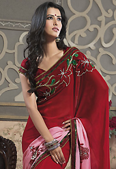 It is color this season and bright shaded suits are really something that is totally in vogue. This dark red and shaded pink faux georgette saree have beautiful embroidery patch work which is embellished with resham, zari, stone, beads and lace work. Fabulous designed embroidery gives you an ethnic look and increasing your beauty. Matching blouse is available. Slight Color variations are possible due to differing screen and photograph resolutions.