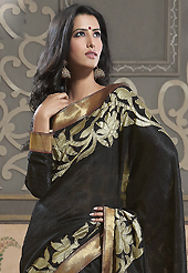 Style and trend will be at the peak of your beauty when you adorn this saree. This black shimmer georgette saree have beautiful embroidery patch work which is embellished with resham, zari and stone work. Fabulous designed embroidery gives you an ethnic look and increasing your beauty. Matching blouse is available. Slight Color variations are possible due to differing screen and photograph resolutions.