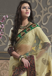 Take a look on the changing fashion of the season. This light fawn net and dupion silk saree have beautiful embroidery patch work which is embellished with resham, zari and stone work. Fabulous designed embroidery gives you an ethnic look and increasing your beauty. Matching blouse is available. Slight Color variations are possible due to differing screen and photograph resolutions.