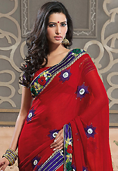 The traditional patterns used on this saree maintain the ethnic look. This red faux georgette saree have beautiful embroidery patch work which is embellished with resham, zari, stone, beads and lace work. Fabulous designed embroidery gives you an ethnic look and increasing your beauty. Matching blouse is available. Slight Color variations are possible due to differing screen and photograph resolutions.