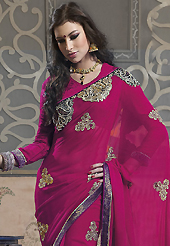An occasion wear perfect is ready to rock you. This magenta faux georgette saree have beautiful embroidery patch work which is embellished with resham, zari, stone, beads and lace work. Fabulous designed embroidery gives you an ethnic look and increasing your beauty. Matching blouse is available. Slight Color variations are possible due to differing screen and photograph resolutions.