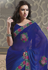 The most beautiful refinements for style and tradition. This blue faux georgette saree have beautiful embroidery patch work which is embellished with resham, stone and beads work. Fabulous designed embroidery gives you an ethnic look and increasing your beauty. Matching blouse is available. Slight Color variations are possible due to differing screen and photograph resolutions.