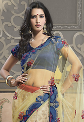 Your search for elegant look ends here with this lovely saree. This light yellow, fawn and blue net and viscose lehenga style saree have beautiful embroidery patch work which is embellished with resham, zari and lace work. Fabulous designed embroidery gives you an ethnic look and increasing your beauty. Matching dark blue blouse is available. Slight Color variations are possible due to differing screen and photograph resolutions.