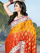Take a look on the changing fashion of the season. This yellow, dark orange and red viscose saree is nicely designed with embroidered patch work is done with zari, sequins, stone and lace work. Saree gives you a singular and dissimilar look. Contrasting blue blouse is available. Slight color variations are possible due to differing screen and photograph resolution.