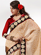 Let your personality articulate for you with this amazing embroidered saree. This fawn chiffon saree is nicely designed with embroidered patch work is done with resham and lace work. Saree gives you a singular and dissimilar look. Contrasting dark red blouse is available. Slight color variations are possible due to differing screen and photograph resolution.