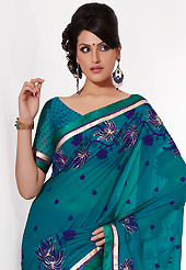 The traditional patterns used on this saree maintain the ethnic look. This teal georgette saree is nicely designed with embroidered patch work is done with resham, zari and lace work. Saree gives you a singular and dissimilar look. Matching blouse is available. Slight color variations are possible due to differing screen and photograph resolution.
