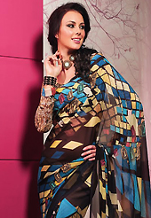 Exquisite combination of color, fabric can be seen here. This beautiful deep brown and blue faux georgette saree is nicely designed with geometric print work. Beautiful print work on saree make attractive to impress all. It will enhance your personality and gives you a singular look. Matching blouse is available with this saree. Slight color variations are due to differing screen and photography resolution.