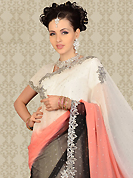 Take a look on the changing fashion of the season. This off white, peach and black chiffon saree is nicely designed with embroidery patch work is done with resham, cutdana and stone work. This saree gives you a modern and different look in fabulous style. Matching blouse is available with this saree. Slight color variations are possible due to differing screen and photograph resolution.
