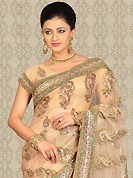The traditional patterns used on this saree maintain the ethnic look. This light peach net saree is nicely designed with embroidery patch work is done with resham, sequins, stone and cutdana work. This saree gives you a modern and different look in fabulous style. Matching blouse is available with this saree. Slight color variations are possible due to differing screen and photograph resolution.